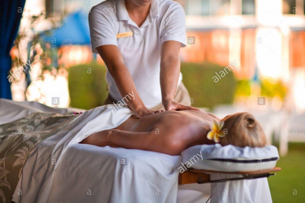 woman receiving massage in spa resort fairmont kea lani outdoor gazebo spa wailea maui hawaii usa X2CAMM